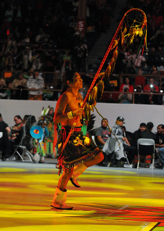 jt042817s/a sec/jim thompson/ Justin Casiquito of Jemeiz Pueblo carries a feathered staff  to the center floor of  Tingley Coliseum  before the start of the Grand Entrance of the 2017 Gathering of Nations Pow-Pow.  Friday April 28, 2017. (Jim Thompson/Albuquerque Journal)