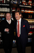Peter Akroyd and Lord Melvyn Bragg, Hatchards christmas party, Piccadilly, 4 December 2003. © Copyright Photograph by Dafydd Jones 66 Stockwell Park Rd. London SW9 0DA Tel 020 7733 0108 www.dafjones.com