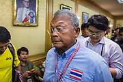 12 MAY 2014 - BANGKOK, THAILAND: SUTHEP THAUGSUBAN walks into a meeting with Thai Senators at the Parliament building in Bangkok. Several thousand protestors with the People's Democratic Reform Committee (PDRC) blocked access to the Thai Parliament building in Bangkok as a part of their continuing anti-government protests. The Parliament is not currently in session and was dissolved by former Prime Minister Yingluck Shinawatra but the Senate is in session. The protestors are demanding that the Senate dissolve the current Pheu Thai caretaker government and appoint a new Prime Minister and cabinet. Members of the Senate leadership met with Suthep Thaugsuban Monday to discuss the impasse.   PHOTO BY JACK KURTZ
