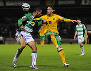Yeovil - Tuesday, August 11th, 2009: Nathan Jones of Yeovil and Cody McDonald of Norwich City during the Carling Cup 1st Round match at Yeovil. (Pic by Alex Broadway/Focus Images)