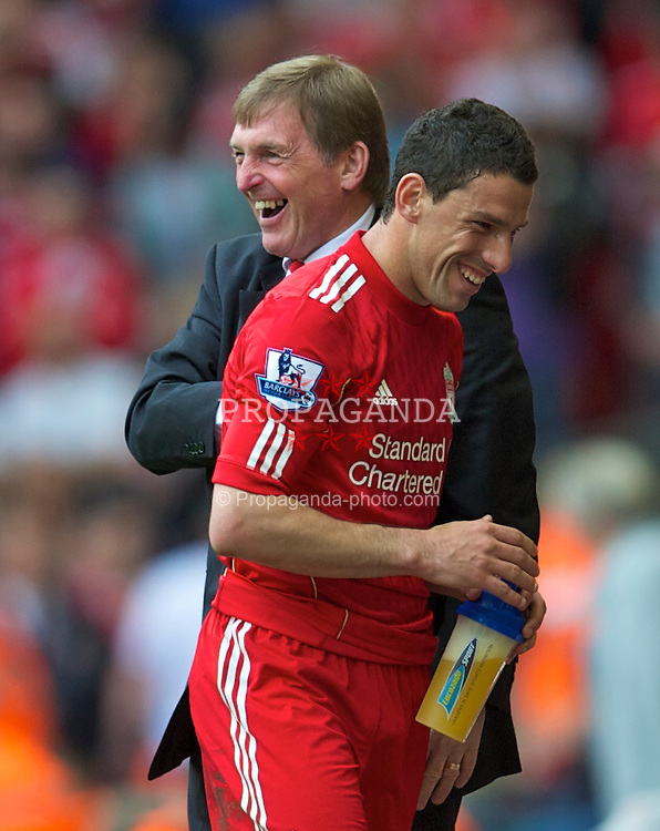 LIVERPOOL, ENGLAND - Saturday, April 23, 2011: Liverpool's manager Kenny Dalglish MBE congratulates Maximiliano Ruben Maxi Rodriguez on his hat-trick against Birmingham City during the Premiership match at Anfield. (Photo by David Rawcliffe/Propaganda)