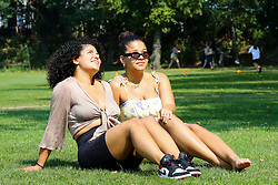 © Licensed to London News Pictures. 27/08/2019. London, UK. Women enjoy weather in Finsbury Park, north London as the hot weather continues in the capital. <br /> <br /> ***Permission Granted***<br /> <br /> Photo credit: Dinendra Haria/LNP