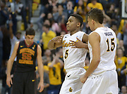 Dec 19, 2013; Long Beach, CA, USA; Long Beach State 49ers guard Mike Caffey (5) celebrates with guard A.J. Spencer (15) during the game against the Southern California Trojans at Walter Pyramid. Long Beach State defeated USC 72-71.