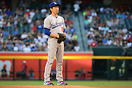 PHOENIX, AZ - JUNE 14:  Kenta Maeda #18 of the Los Angeles Dodgers prepares to deliver a pitch in the first inning of the game against the Arizona Diamondbacks at Chase Field on June 14, 2016 in Phoenix, Arizona. Los Angeles Dodgers won 7-4.  (Photo by Jennifer Stewart/Getty Images)