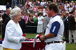 HM THE QUEEN and  TONY PIDGLEY at the Queen's Cup polo final sponsored by Cartier at Guards Polo Club, Smith's Lawn, Windsor Great Park on 18th June 2006.  The Final was between Dubai and the Broncos polo teams with Dubai winning.<br />