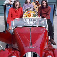 "Fairfield Parlour pre-festival publicity shoot (with Red Morgan).- .Once known as Kaleidoscope, the group re-launched their career in 1970 as Fairfield Parlour,via a quick pseudonym as ""I Luv Wight"" under which name they wrote the opening theme to the festival ""Let the World Wash In"". It went down like a lead balloon, but allowed them the chance to appear as the opening act, opening their horizons to even greater successes"