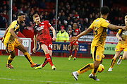 Matt Harrold of Crawley Town plays a pass across the edge of the box to a teammate during the Sky Bet League 2 match between Crawley Town and Cambridge United at the Checkatrade.com Stadium, Crawley, England on 9 January 2016. Photo by Andy Walter.