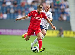 PRESTON, ENGLAND - Saturday, July 19, 2014: Liverpool's Fabio Borini in action against Preston North End's Keith Keane during a preseason friendly match at Deepdale Stadium. (Pic by David Rawcliffe/Propaganda)