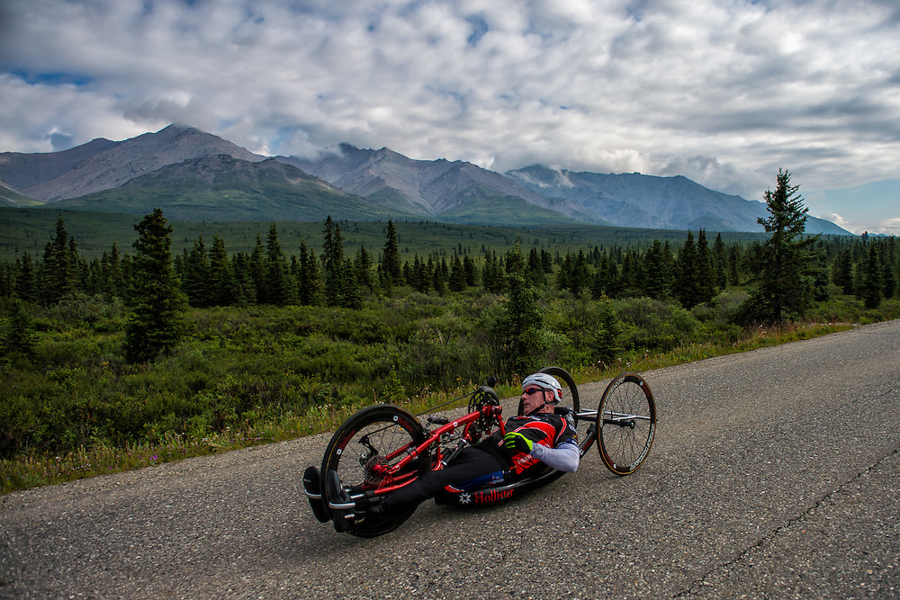 July 25, 2015: Kenny Herriot races along Denali Park Road during stage five of the 2015 Alaska Challenge handcycle race.