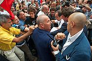 Roma 12 Settembre 2011.Manifestazione del sindacato  Usb  contro la manovra del governo Berlusconi davanti alParlamento..Manifestanti espongono uno striscione  contro la guerra in Libia  e  contro il Presidente della Repubblica Giorgio Napolitano e contro il Presidente del Consiglio Silvio Berlusconi definendoli  assassini, la polizia interviene per togliere lo striscione i manifestanti  si oppongono