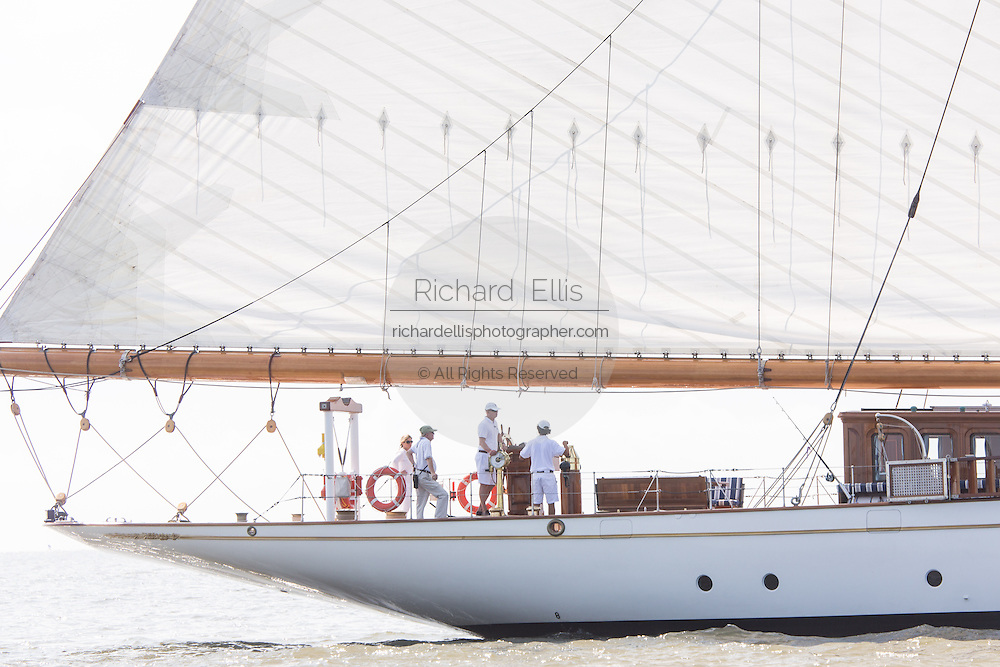 The crew steers the 196-foot sailing yacht Germania Nova as it sails Charleston Harbor June 26, 2013 in Charleston, South Carolina.