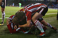 Football - 2019 / 2020 Emirates FA Cup - Second Round: Portsmouth vs. Altrincham<br /> <br /> Altrincham players mob goalscorer of Altrincham Josh Hancock of Altrincham after his penalty equaliser at Fratton Park <br /> <br /> COLORSPORT/SHAUN BOGGUST