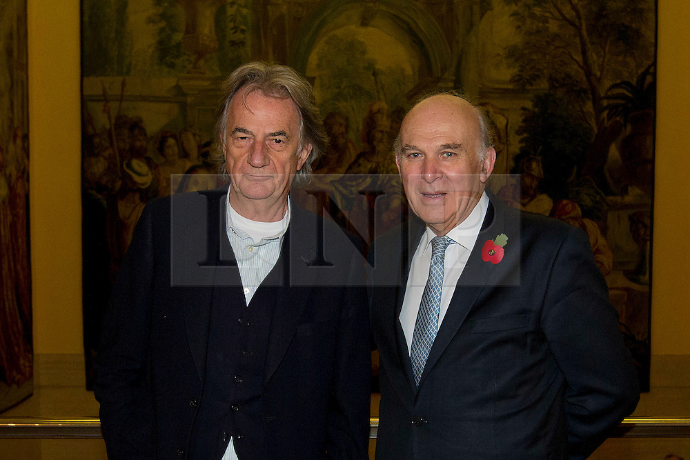 © Licensed to London News Pictures. 02/11/2012. London, UK. Fashion designer Paul Smith is seen with Vince Cable, the Secretary of State for Business, Innovation and Skills, ahead of a textiles conference at the Clothworkers Hall in London today (02/11/12). The conference called 'A New Dawn - Rebuilding UK Textile Manufacturing' explores the issues forcing the textile industry including the benefits of sourcing and manufacturing in the UK. Photo credit: Matt Cetti-Roberts/LNP