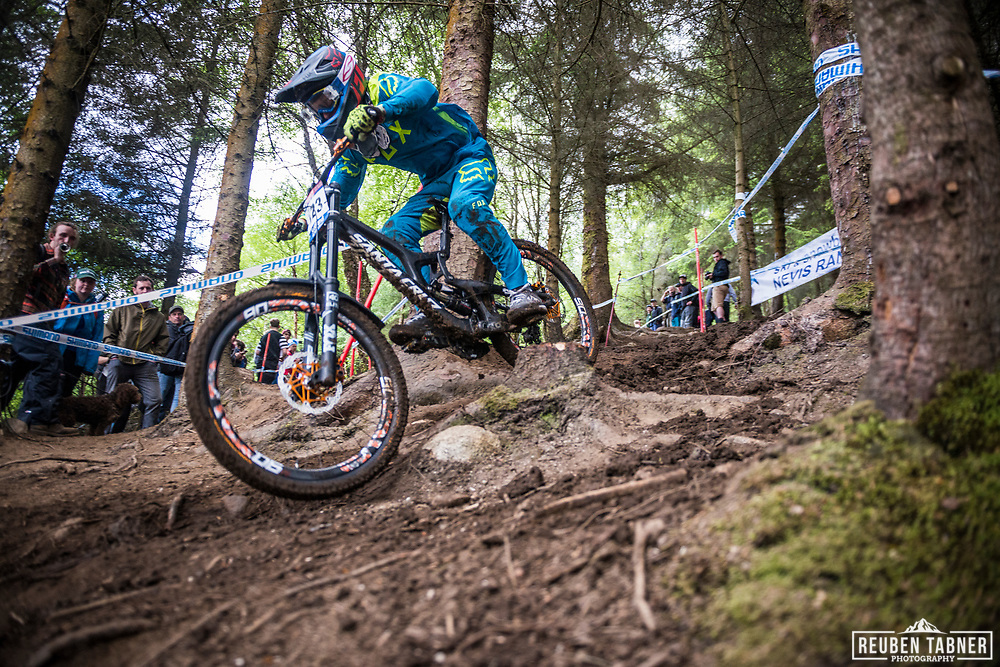 Scott Mears finding his way through the trees during qualifying at the UCI Mountain Bike World Cup at Fort William.