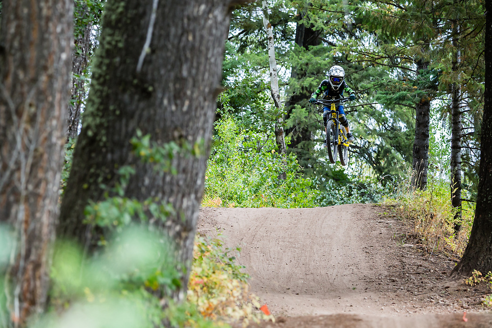 Micah Goodrich riding and getting air in the bike park at age 7.