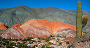 "Purmamarca And The Hill of Seven Colors<br /> <br /> Cerro de los Siete Colores or ""The Hill of Seven Colors"" is one of the hills bordering the tiny village of Purmamarca, in Jujuy Province, in north-western Argentina. Sprung up around seventy-five million years ago, the hill was formed by a complex geological process that involved deposition of sea, lake and river movements and subsequent elevation of the land due to the movement of the tectonic plates. The hill is called such due to the various pigments acquired by the minerals that make up the sedimentary layers. It is said that you can see seven colors in the hill, but most people can pick out only four. The colors are most clearly visible in the morning. The hill is best seen from the main road about 400 meters before entering the village.<br /> ©Amazing Planet/Exclusivepix"