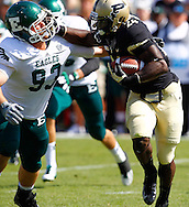 WEST LAFAYETTE, IN - SEPTEMBER 15:  Defensive lineman Cy Maughmer #93 of the Eastern Michigan Eagles reaches to make the tackle on running back Akeem Shavers #24 of the Purdue Boilermakers at Ross-Ade Stadium on September 15, 2012 in West Lafayette, Indiana. (Photo by Michael Hickey/Getty Images)***Local Caption***Cy Maughmer; Akeem Shavers