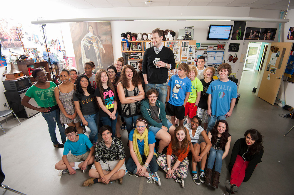 Theater arts teacher Steward Savage poses for a photograph with his students at Carnegie Vanguard High School, April 23, 2013.