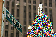 Rockefellre Plaza street sign and Rockefeller Center Christmas Tree, New York city on December 22 2007
