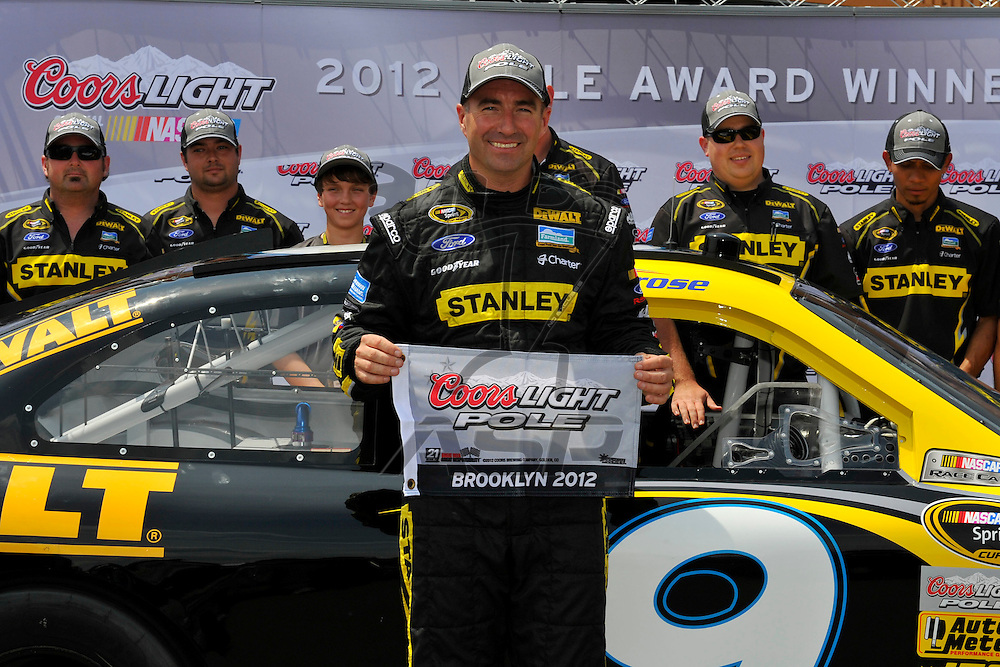 Brooklyn, MI - JUN 16, 2012: Marcos Ambrose (9) wins the pole award during for the Quicken Loans 400 race at the Michigan International Speedway in Brooklyn, MI.