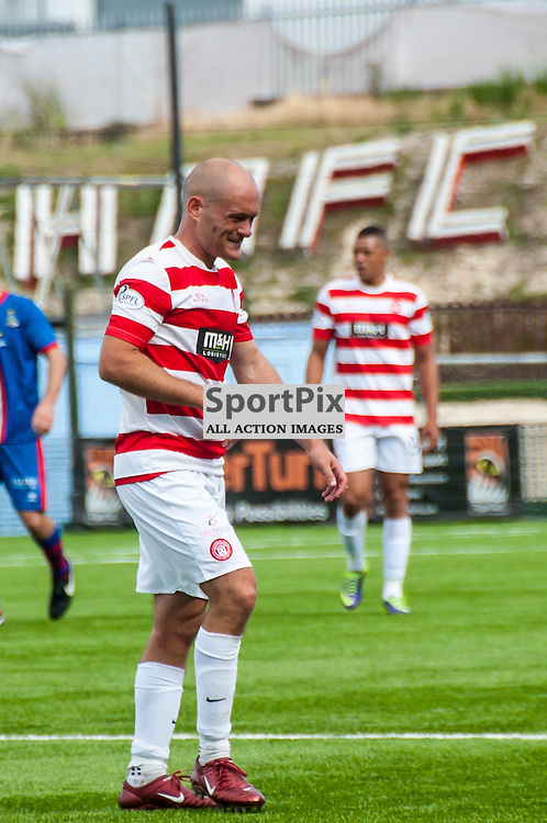 Hamilton Accies Player-manager Alex Neil trudges off after a 2-0 defeat by Inverness Caledonian Thistle on the opening day of the Scottish Premiership at New Douglas Park in Hamilton, 9 August 2014. (c) Paul J Roberts / Sportpix.org.uk