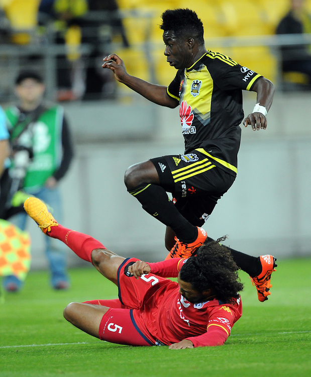 Phoenix's Jeffery Sarpong leaps Adelaide United's Osama Malik in the A-League football match at Westpac Stadium, Wellington, New Zealand, Friday, November 13, 2015. Credit:SNPA / Ross Setford