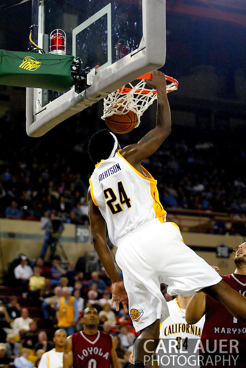 11/25/2006 - Anchorage, Alaska: Theo Robertson (24) elevates for a slam dunk against Loyola Marymount as the California Golden Bears beat LMU 78-70 to capture the championship title of the 2006 Great Alaska Shootout<br />