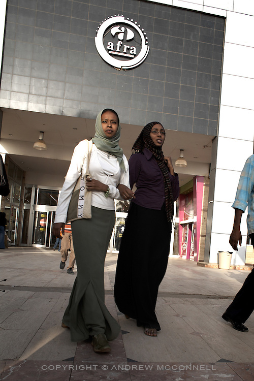 Locals shop at the Afra mall in Khartoum, Sudan, on Thursday, Apr. 12, 2007. Khartoum's first mall 'Afra' opened in 2004 and has become popular with affluent Sudanese..Khartoum is modeling itself as the Dubai of Africa and despite Western sanctions the city is booming. Away from the troubles and poverty that plaque the rest of Sudan, development in Khartoum is moving at an astonishing rate. Investment from the East, and in particular China, allowed the Sudanese economy to grow by 11% in 2007. This growth is driven largely by oil, with production rising from 63,000 barrels per day in 1999 to over 500,000 barrels today.