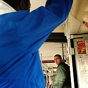 A German skin head stares at a Cameronian refugee on a bus in the eastern German city of Cottbus, near Berlin in the state of Brandenburg. Picture taken 2000 by Justin Jin. ..