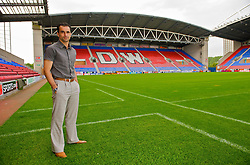 WIGAN, ENGLAND - Monday, August 24, 2009: Wigan Athletic's manager Roberto Martinez in the technical area on the pitch at the club's DW Stadium. (Photo by David Rawcliffe/Propaganda)