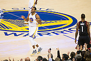 Golden State Warriors forward Andre Iguodala (9) celebrates a jumper against the Houston Rockets at Oracle Arena in Oakland, Calif., on December 1, 2016. (Stan Olszewski/Special to S.F. Examiner)