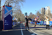 Donnie Jack, left, Scottish Affairs Counsellor for the Americas, and Kate Perkins, Second Secretary for Scottish Affairs, hold the tape as Werkuneh Seyoum Aboye, of Ethiopia, wins the 12th annual Scotland Run in New York's Central Park, Saturday, April 4, 2015, as part of Scotland Week.  (Photo by Diane Bondareff/Invision for Scottish Government/AP Images)