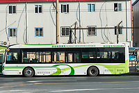Shanghai, China - April 7, 2013: electric powered hybrid bus charging at the city of Shanghai in China on april 7th, 2013
