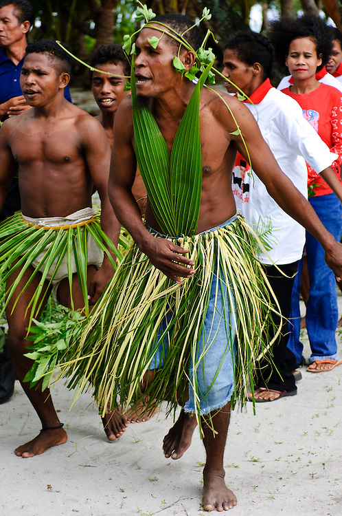 Traditional performers, Mapia Atoll, West Papua, Indonesia. Mapia is a remote atoll situated north of the Bird's Head Peninsula, West Papua.