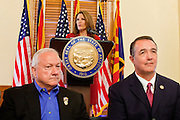 17 OCTOBER 2011 - PHOENIX, AZ:  MICHELE BACHMANN, a Republican candidate for US President, flanked by Arizona State Senator RUSSELL PEARCE, left, and Arizona Congressman TRENT FRANKS, right, talks to members of the Arizona legislators at the State Capitol in Phoenix. Bachmann met with Republican Arizona legislators and Republican members of the state's Congressional delegation Monday morning to talk about illegal immigration and border security. During the meeting she pledged that if she were elected US President, she would construct a fence along the US - Mexico border.   PHOTO BY JACK KURTZ
