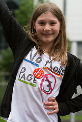 © Licensed to London News Pictures. 18/05/2013. London, UK. Ffion Staniland, aged 12 from the No More Page 3 campaign takes part in a 1970's themed flash mob outside News International offices in Wapping, East London on 18 May 2013 with their own version of YMCA. The No More Page 3 campaign wants Dominic Mohan, Editor of The Sun newspaper, to stop using photos of topless female models in the daily newspaper. Photo credit : Vickie Flores/LNP
