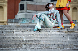 © London News Pictures. 17/09/2013 . London, UK.   A Performer from Cirque Du Soleil sits on a step outside The Royal Albert Hall in London before a photo call for the Cirque Du Soleil production 'Quidam' which is due to run in London from July 4th 2014.. Photo credit : Ben Cawthra/LNP