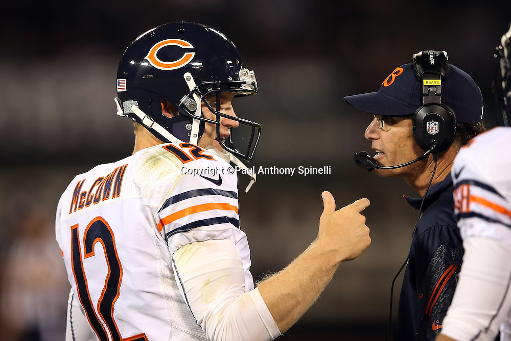 Chicago Bears head coach Marc Trestman looks talks to Chicago Bears quarterback Josh McCown (12) during a sideline break during the NFL preseason week 3 football game against the Oakland Raiders on Friday, Aug. 23, 2013 in Oakland, Calif. The Bears won the game 34-26. ©Paul Anthony Spinelli