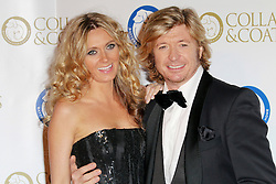 © Licensed to London News Pictures. 07/11/2013.  Nicky Clarke and Kelly Simpkin at the Battersea Dogs & Cats Home Collars & Coats Gala Ball at Battersea Evolution, London UK. Photo credit: by Richard Goldschmidt/LNP
