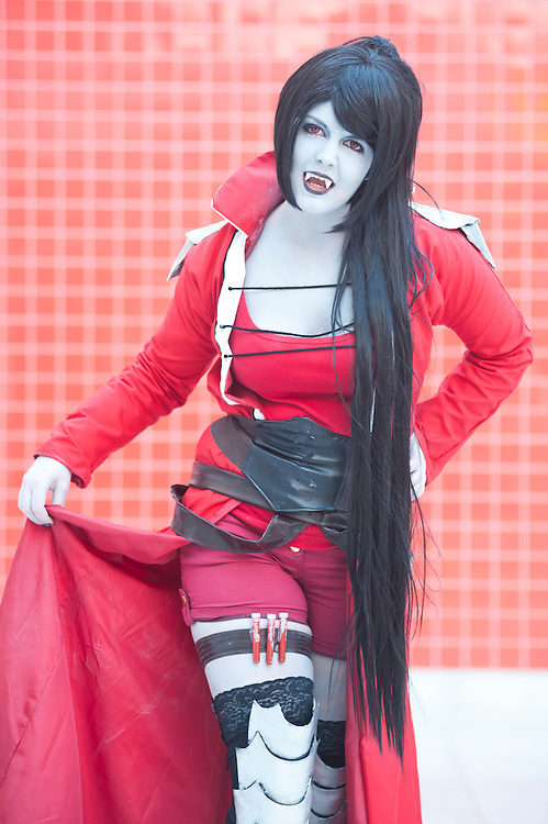 London, UK - 26 May 2013: Alison Richards dressed as Marceline from Adventure Time  poses for a picture during the London Comic Con 2013 at Excel London. London Comic Con is the UK's largest event dedicated to pop culture attracting thousands of artists, celebrities and fans of comic books, animes and movie memorabilia.