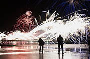 Cromer Town Council's 17th annual New Year's Day firework display off the pier. Pictured are photographers on the beach capturing the display. <br /> <br /> Picture: MARK BULLIMORE