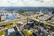 Nederland, Noord-Holland, Amsterdam, 14-06-2012; Westpoort, Nieuwe Hemweg met centrales van Nuon. Centrale Hemweg 8 met schoorsteen met witte bies is kolengestookt, Centrale Hemweg 7 is gasgestookt..Op het tweede plan de Ring A10 (A10 West), rechts de Westrandweg in aanbouw. Amsterdam-West aan de horizon..View on Westpoort (port, industrial and office area) in the western harbour area of Amsterdam, with the Nuon power plant and ringroad A10. City of Amsterdam in the back ..luchtfoto (toeslag), aerial photo (additional fee required).foto/photo Siebe Swart
