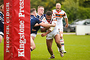 Bradford Bulls prop Colton Roche (11) powers through  during the Kingstone Press Championship match between Swinton Lions and Bradford Bulls at the Willows, Salford, United Kingdom on 20 August 2017. Photo by Simon Davies.