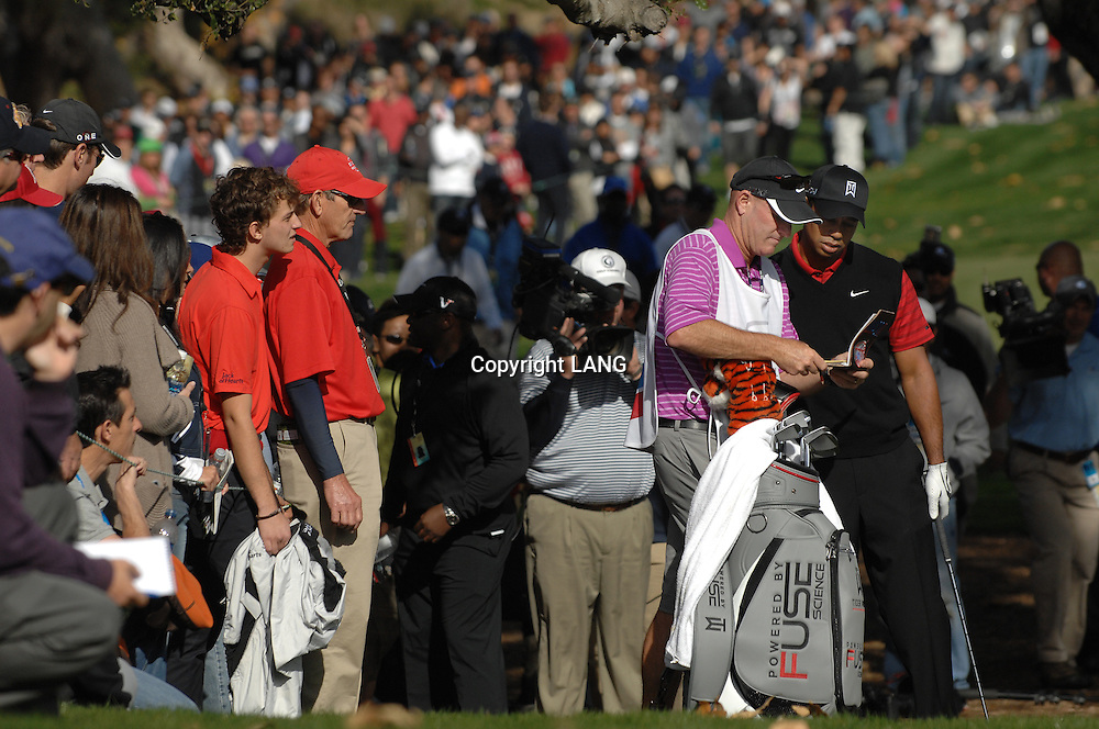 Joe LaCava and Tiger Woods look at the yardage book while next to the ropes on the right side of the 5th fairway during the final round of The Chevron World Challenge at Sherwood Country Club. Thousand Oaks, CA 12/04/2011(John McCoy/Staff Photographer)