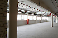 Empty warehouse room with windows