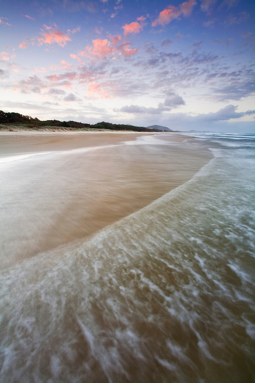 The extensive golden sands and breaking waves stretch out into the distance showing off the simple beauty of the Sunshine Coast.