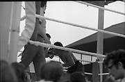 Ali vs Lewis Fight, Croke Park,Dublin..1972..19.07.1972..07.19.1972..19th July 1972..As part of his built up for a World Championship attempt against the current champion, 'Smokin' Joe Frazier,Muhammad Ali fought Al 'Blue' Lewis at Croke Park,Dublin,Ireland. Muhammad Ali won the fight with a TKO when the fight was stopped in the eleventh round...Image of Lewis as he gets in a good right hand to Alis' ribs.