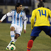 Ever Banega, (left), Argentina, is challenged by Segundo Castillo, Ecuador, during the Argentina Vs Ecuador International friendly football match at MetLife Stadium, New Jersey. USA. 15th November 2013. Photo Tim Clayton