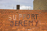 'Support Jeremy' (Corbyn, - the left-wing Labour leader elected in September 2015) writing on a Peckham, south London brick wall.