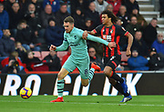 Aaron Ramsey (8) of Arsenal battles for possession with Nathan Ake (5) of AFC Bournemouth during the Premier League match between Bournemouth and Arsenal at the Vitality Stadium, Bournemouth, England on 25 November 2018.